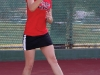Kassie Beadle returns a serve from her Glendale College opponent at a home match on Feb. 23.