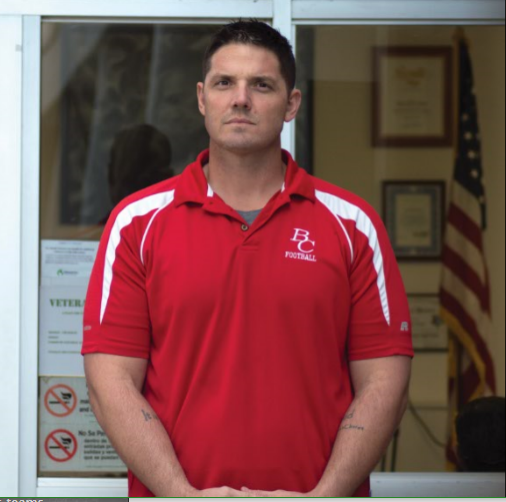 Jeremy Staat poses for a photo near the Veterans Center.