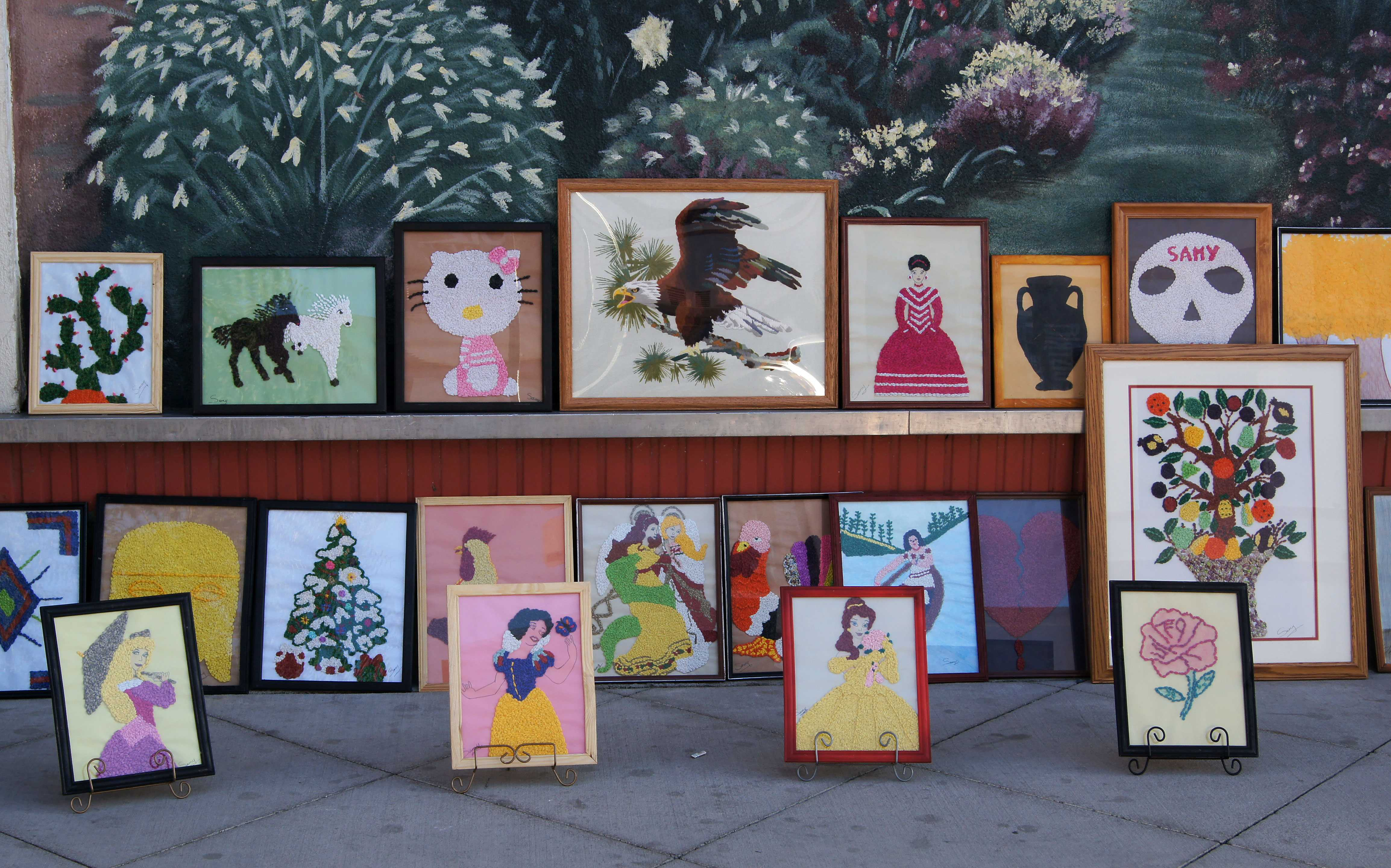 Art for sale on sidewalk during First Friday on September 2 in downtown Bakersfield.