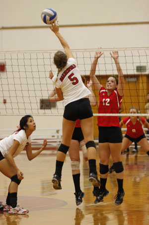 Outside hitter Sarah Horcher dinks the ball over the net against Porterville on Sept. 7.