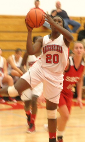Women's hoops falls to 1-2 with OT loss