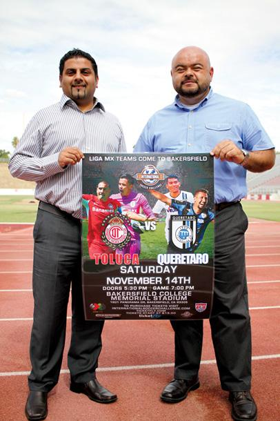 Ranbir Shergill (left) and Polo Ascencio hold a poster for the professional game that will be played at BC's Memorial Stadium on Nov. 14.