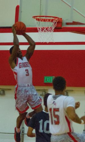 Sophomore guard Shane Christie (3) dunks against LA Pierce.