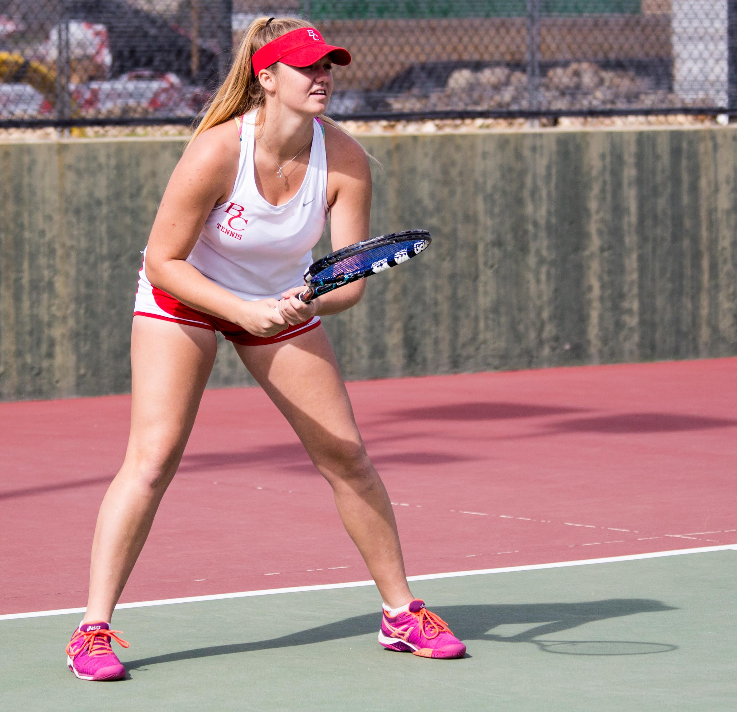 Riley Tucker prepares for her opponent from Folsom Lake to serve on the Wednesday afternoon game on March 8.