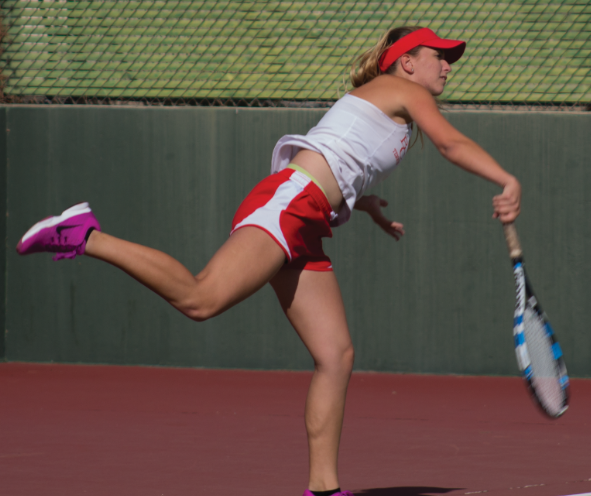 Sophomore Riley Tucker follows through on a serve against Antelope Valley on Feb. 23.