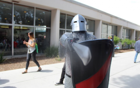 The Bakersfield College knight mascot directs people waiting in line for free ice cream to step back by pointing a sword at them on April 3 during Spring Fling.