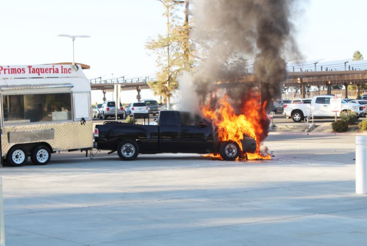 A black truck catches fire in front of the Outdoor Theater before Noche de Cultura.