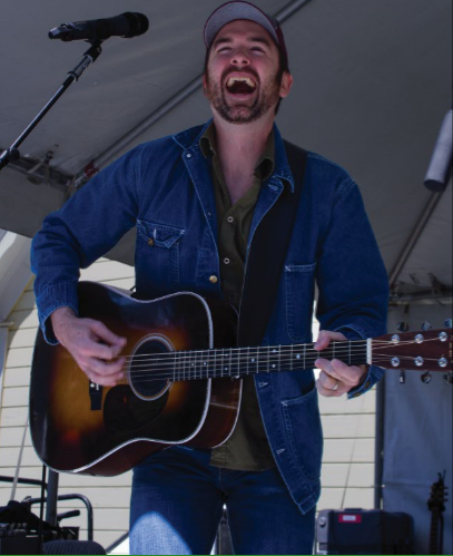 Country music singer James Carothers performs his set at the Kern County Museum Boxcar Festival for fellow artists and attendees.