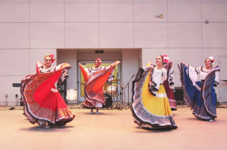 A group of women perform a dance representing Mexican culture during the MEChA event at the Noche De Cultura at BC on April 21.
