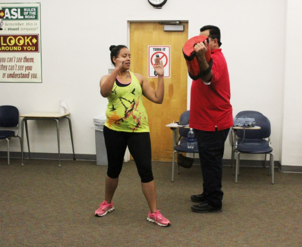 Ambria King trains in defensive punches and blocks at R.A.D. training on April 22.