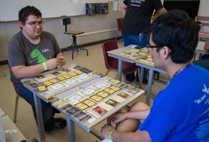 Joe Thornsbery (left) and Mario Hernandez (right) playtest the beta 'Dragon Borne' card game.