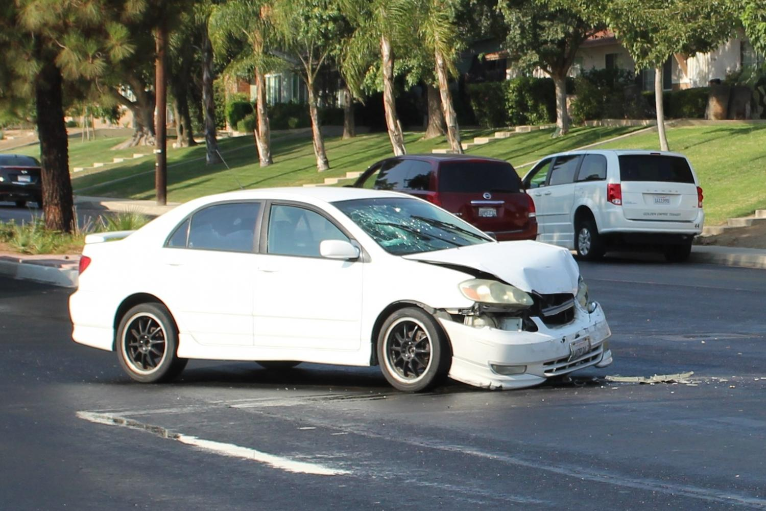 The+car+that+Gallegos+was+driving+sits+on+Mount+Vernon+with+a+broken+windshield+and+debris+after+a+hit-and-run.