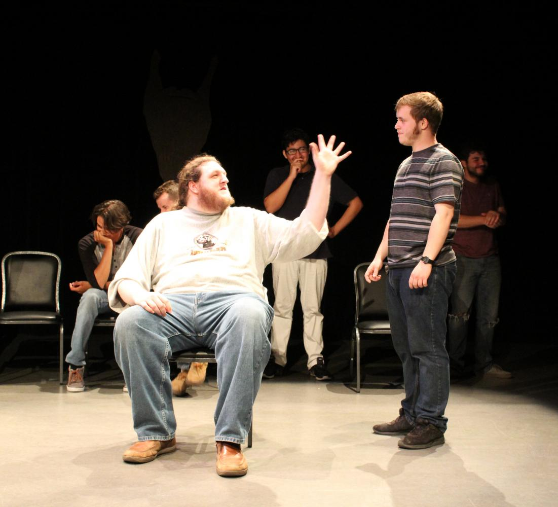 Luke Duffel and Nolan Long play the part of an old man and caretaker during an improv scene on stage at The Black Box in Bakersfield College.