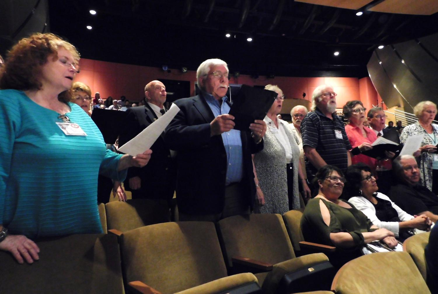 """The 1965 BC Choir sings the song """"The Lord Bless You Keep You,"""" to the audience."""