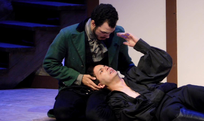 Horatio (Tevin Joslen) holds Hamlet's (Ryan Lee) head.