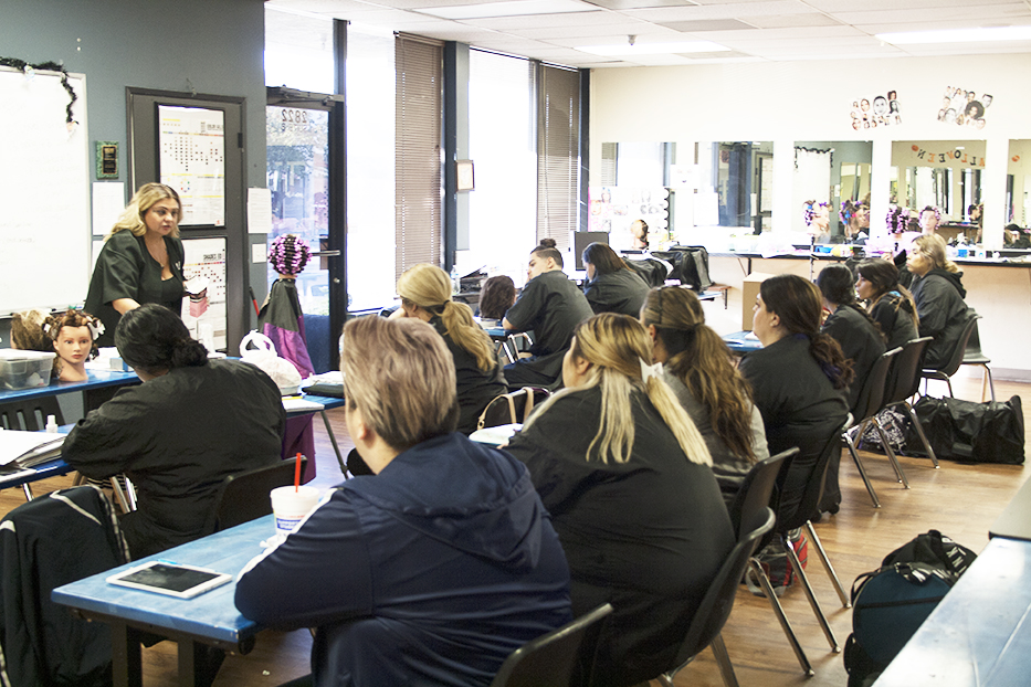 Milan Instructor Rebecca Torres speaks to Phase 1 students during cosmetology training class.