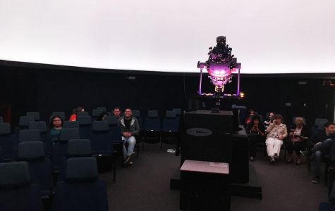 Students explore the night sky from the planetarium
