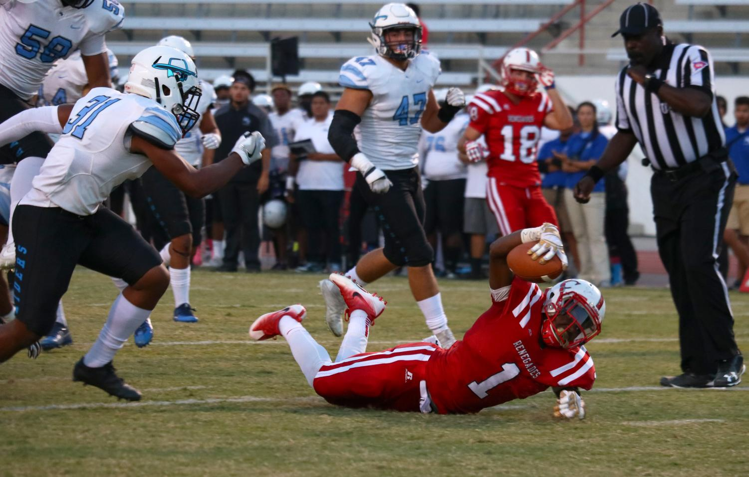 BC Renegade running back Elisha Ortiz breaking Moorpark's defensive line as he inches closer to scoring a touchdown.