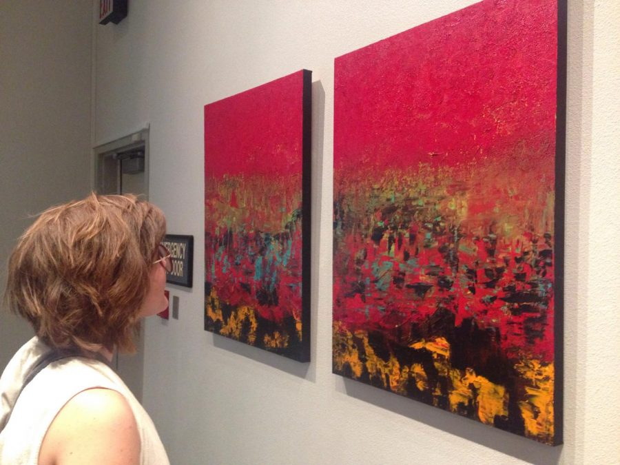 Hannah Pomroy admires a painting by Adel Shafik at the BC art gallery on Sept. 14.