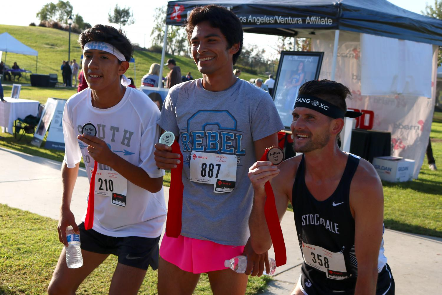 Sebastian Garcia, Mark Gulesian and Ryan Lucker show off their medals after participating in the MADD Dash event.