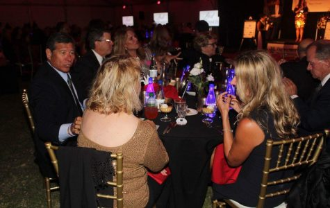 Attendants have dinner while waiting for the live auction to begin at the Couples for CASA red-carpet event.