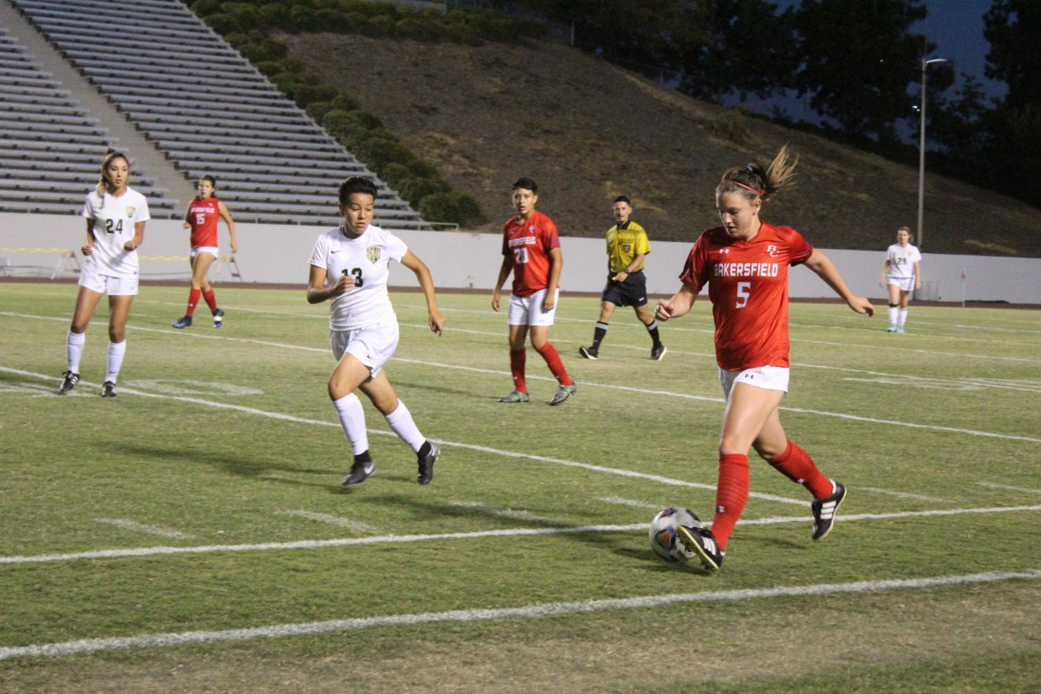 Delaney Boyer is followed by a LA Valley player as she travels the ball toward the opposing teams goal box.