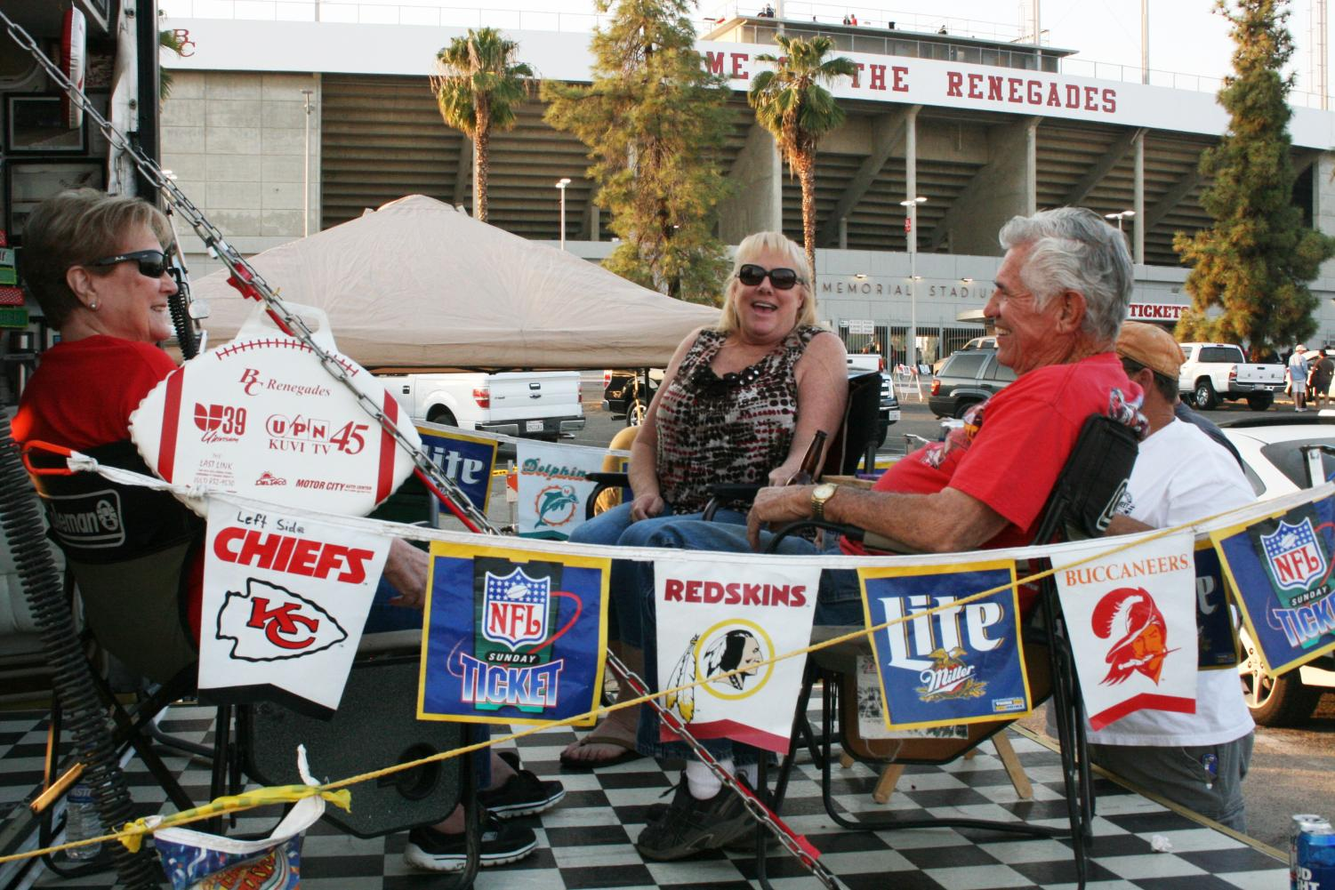From the left: Barbar Lopez, 79, Karen Tallman, 57, James Tallman, 55, and Buddy Lopez, 83 throw their own tailgate party at the homecoming game.