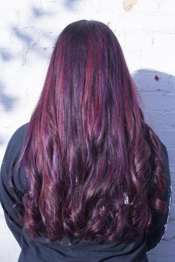 Karla Gutierrez shows of her new purple and magenta hair.