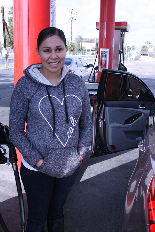 Daina Valdovines, a Bakersfield resident, fills up her gas tank at a Fastrip gas station.