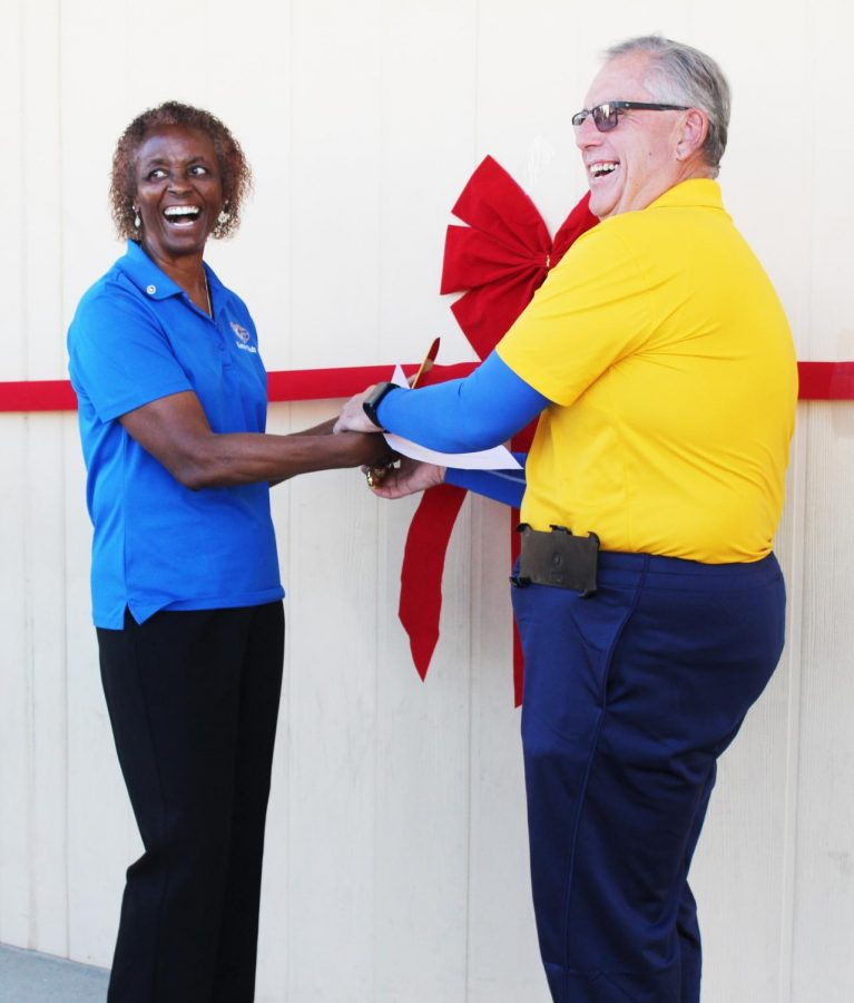 Fuchsia Ward and Fred Kittredge smile before the cutting of the ribbon.