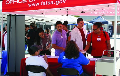 Bakersfield College radiology students talk to financial aid reps at a Office of Financial Aid booth on campus during the Health Connections Fair held on Oct. 5.