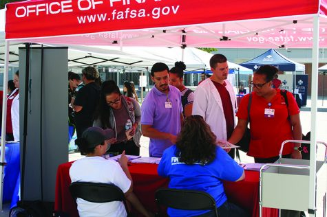 The Office of Financial Aid holds a booth at the Health Connections Fair for scholarships