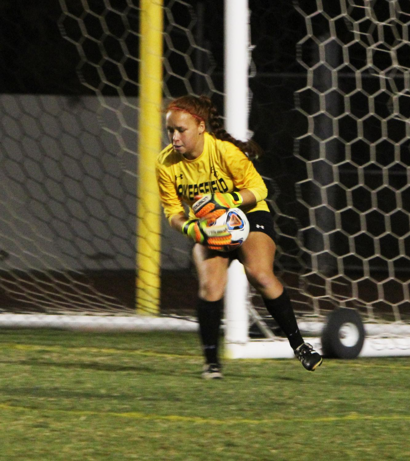 Goalie Taylor Serrano makes a save from an attempted goal.