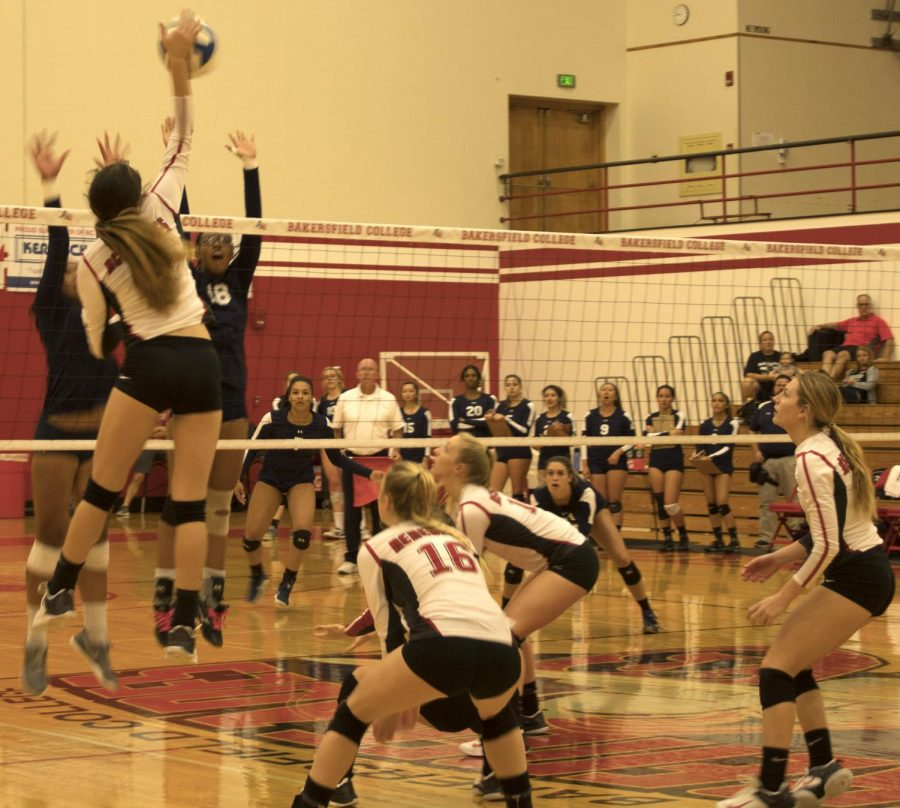Sarah Armendariz, a freshman setter, jumps to spike the volleyball to over the net.