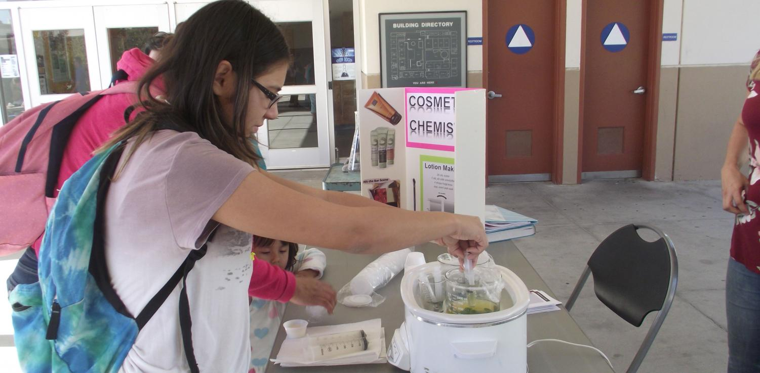 Emily Gibes, an animal science major going to Bakersfield College, measures out hot oil and emulsifier to mix with water and lemon fragrance to create her own lotion.
