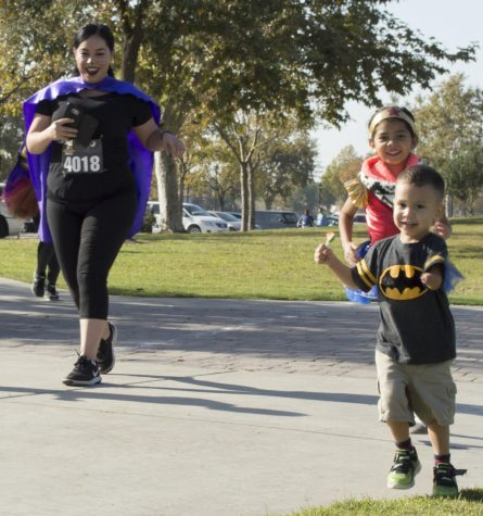 Local residents run 5k in costumes at the Park at Riverwalk for charity at the Haunted Hustle