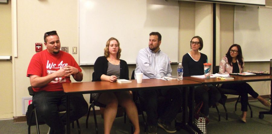 The+other+panelists+listen+as+BC+student+James+Tompkins+%28far+right%29+shares+his+opinion+of+the+book.