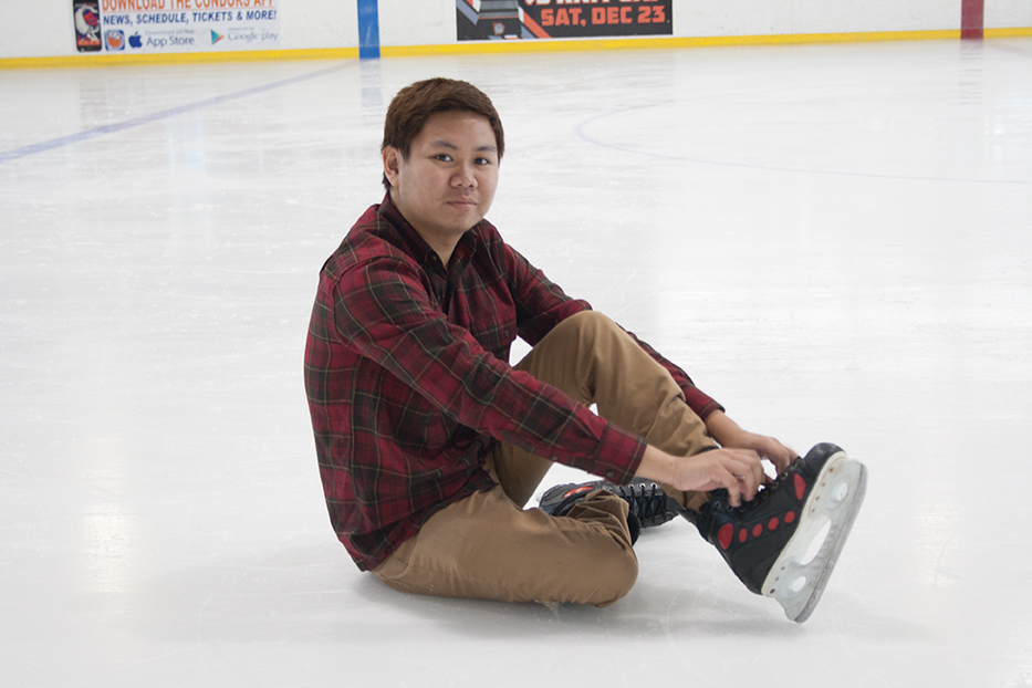 Christopher Cocay smiles at the camera as he ties his shoelaces tighter after taking a fall when his rented ice skating shoes loosened while ice skating on the local ice rink at the Bakersfield Ice Sports Center on Oct. 23.