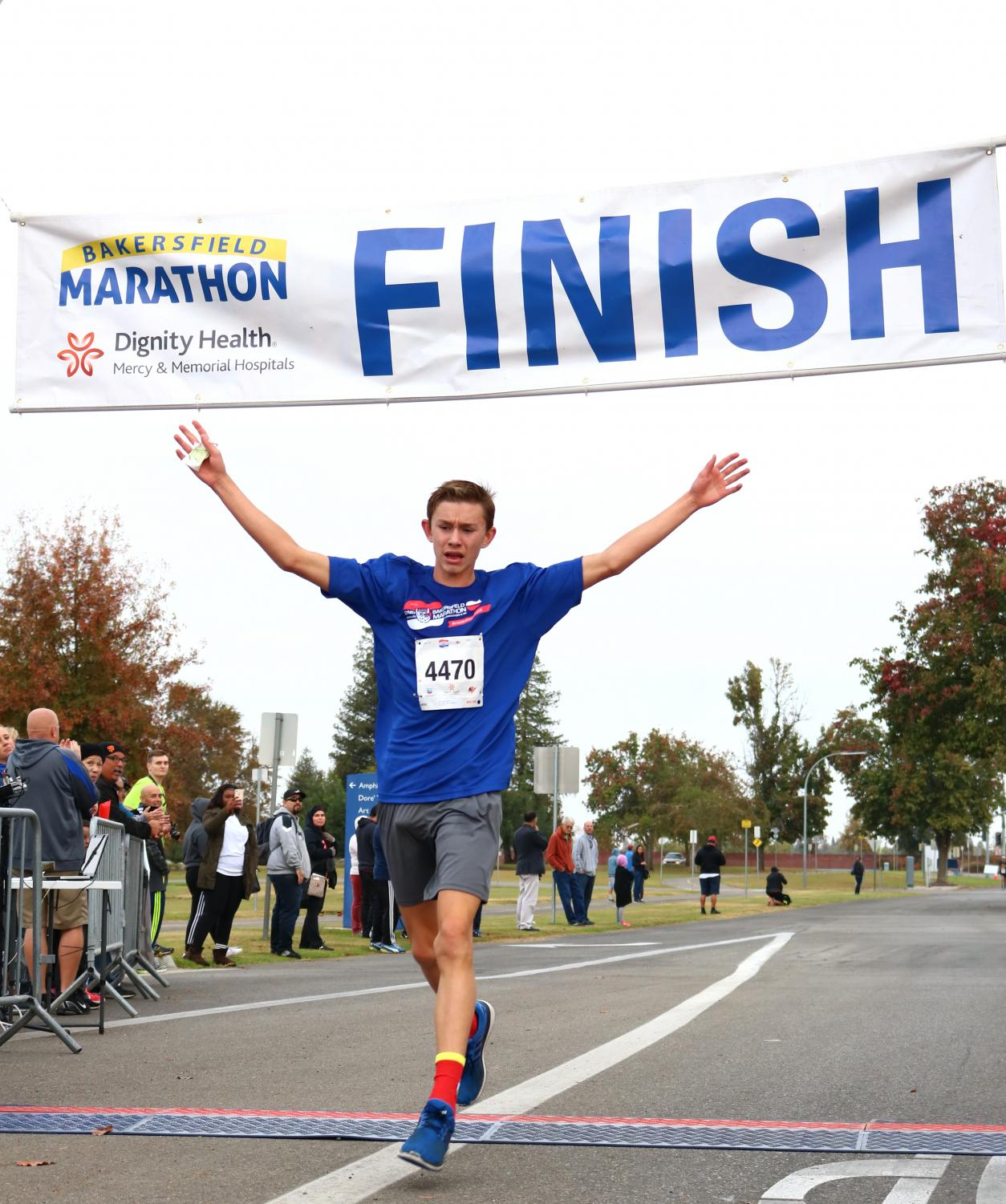 Bakersfield resident Austin Crist crosses the finish line and places third in the 5k race.
