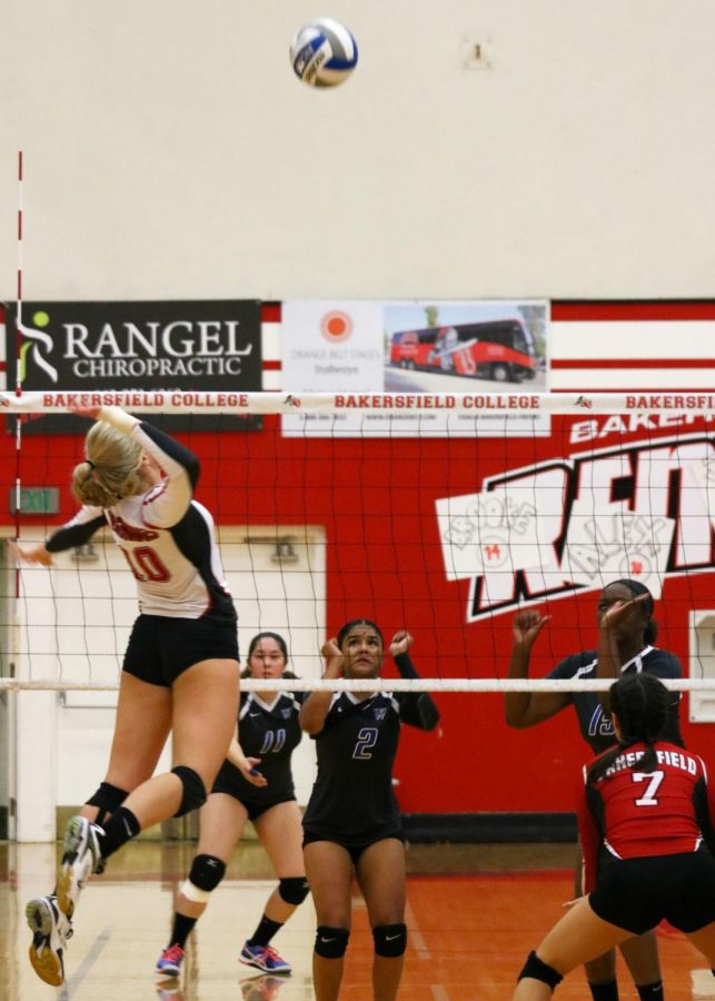 Bakersfield+College+Volleyball+player+Alex+Paris+prepares+to+spike+the+volleyball%2C+jumping+midair%2C+on+West+Los+Angeles+College+during+a+play.