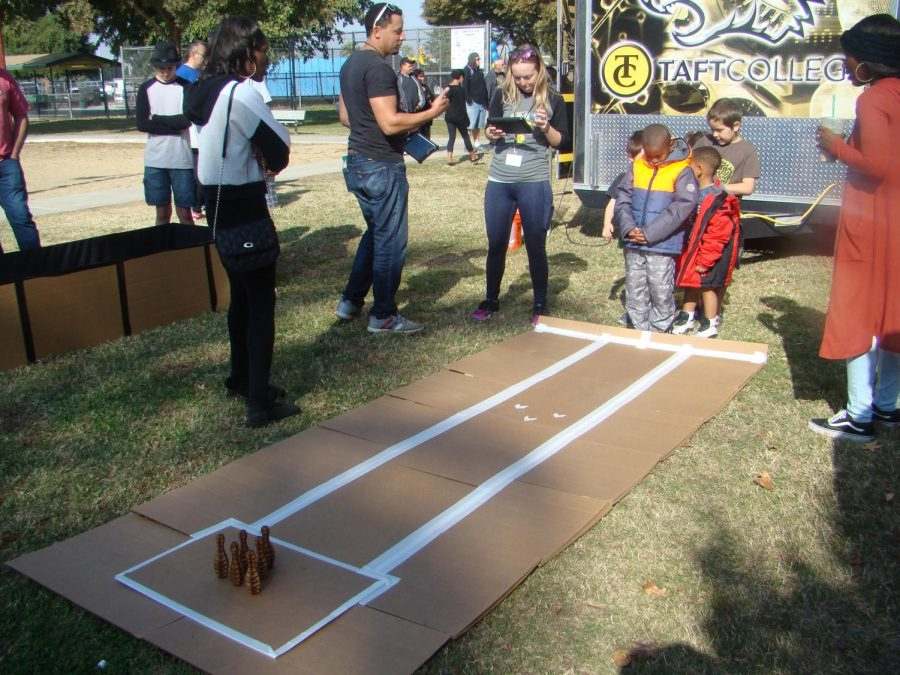 Taft College offering children attending the event to play a bowling game.