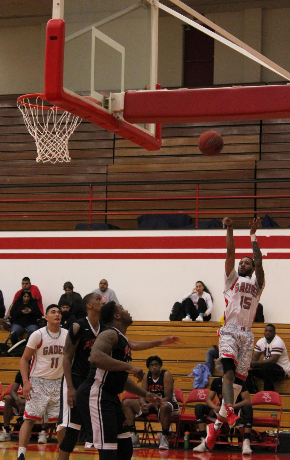 Jamar Hammonds shooting mid-air during the Bakersfield College basketball home game against Los Angeles Pierce College.