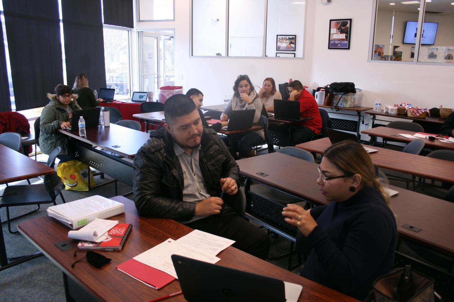 A Bakersfield College Advisor works with a Shafter student who is enrolling at Shafter's Second Express Enrollment Date at the Shafter Learning Center