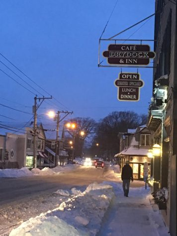A local resident takes a stroll, at dusk, in the town of Tremont Maine