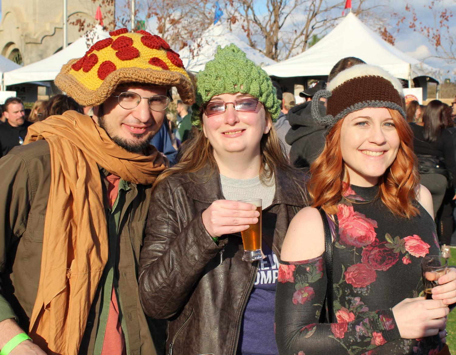 Thomas Powell, Denise Powell, and Shanon Sutton are in the spirit of Pizza and Beer Fest with their unique hats
