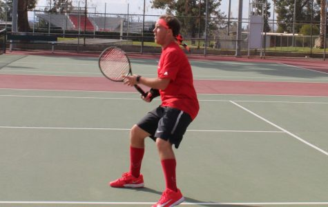 BC player Alec Slykerman waits readily for opponent to serve
