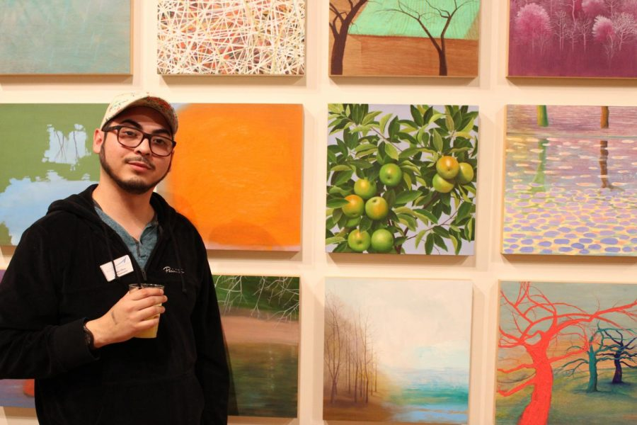 """John Olivo, an instructor with the Bakersfield Museum of Art, guides guests on Astrid Preston's artwork of """"Poetics of Nature."""""""