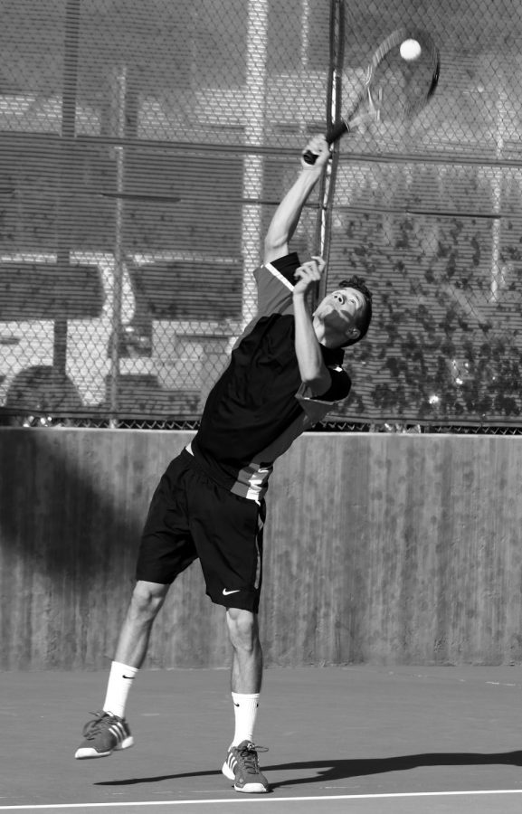BC tennis player Kaleb Johnson returning the ball during his match against a Glendale Community College tennis player.