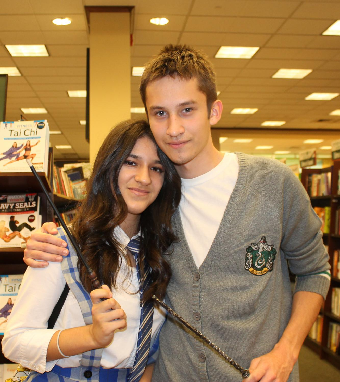 Mayra Lopez and Neil Zuazo attend a Harry Potter celebration dressed as book characters.