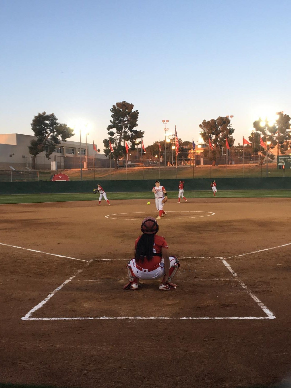 Bakersfield College pitcher Kylee Fahy warms up with catcher Naizemarie Ubay before their double-header against Taft College.